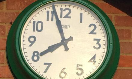 Club legend fixes the clock!